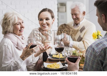 Elegant Family Sitting At The Table