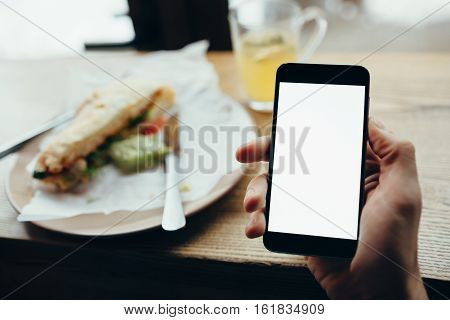 Young Man's Hand Holding Mobile Phone