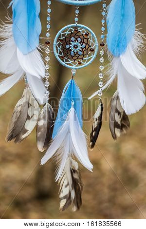 Dreamcatcher made of feathers leather beads and ropes hanging