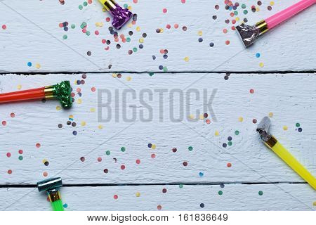 Confetti, photo on wooden floor