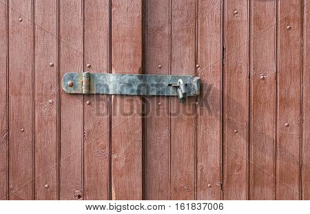 Simple locking system for a gate .