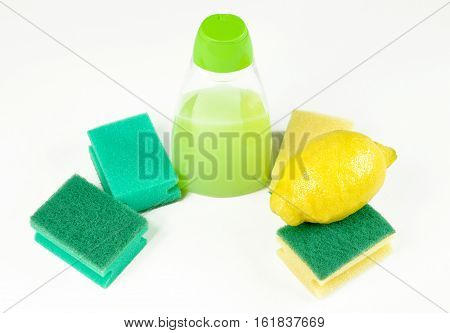 Lemon and cleaning products scouring sponges and detergent bottle
