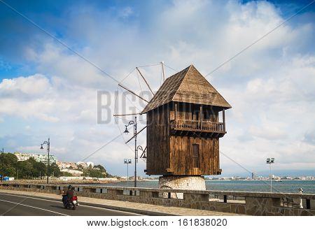 Nesebar Bulgaria - September 05 2014: Old windmill in Nessebar in Bulgaria. Ancient wooden mill. Sunny summer day. Nesebar is an ancient town on the Bulgarian Black Sea Coast. UNESCO world heritage site.
