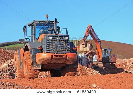 Front loader and digger on a construction site