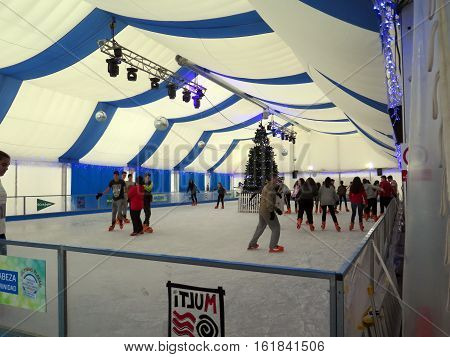 Malaga Spain - December 9 2016: Young people skating in tent in Malaga