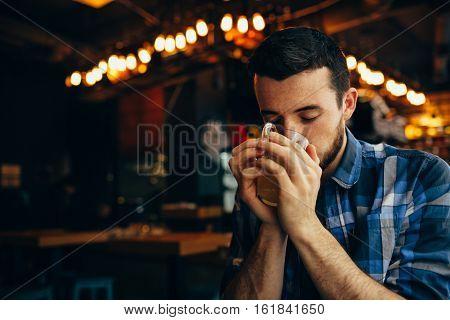 Handsome Natural Man Drinking Tea