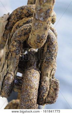 Cluster of corroded iron shackles on aging fishing boat