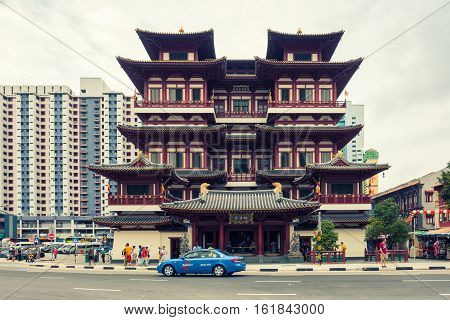SINGAPORE - OCTOBER 23 2016: Chinatown and Tooth Relic Buddha Temple October 23 2016 in Singapore. Singapore's Chinatown is a world famous shopping and food destination.