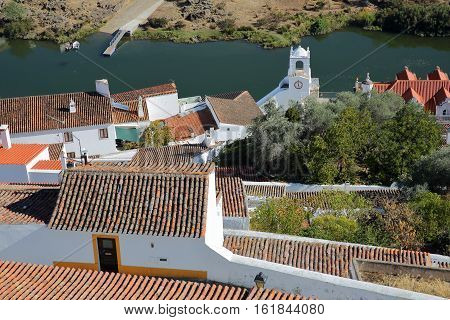 MERTOLA, PORTUGAL: View of the roofs and the river Guadiana from the castle