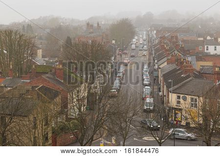 LINCOLN ENGLAND - DECEMBER 15: High view in fog of traffic on Burton Road Lincoln UK. In Lincoln England. On 15th December 2016.