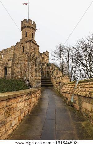 LINCOLN ENGLAND - DECEMBER 15: Lincoln Castle wall leading to the Observatory Tower. In Lincoln England. On 15th December 2016.