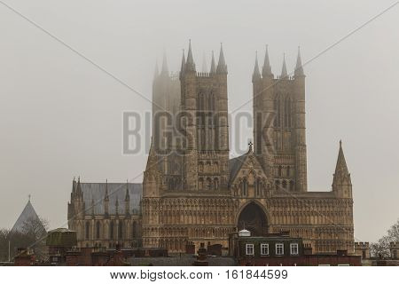 LINCOLN ENGLAND - DECEMBER 15: Tight view of Lincoln Cathedral in the fog. In Lincoln England. On 15th December 2016.