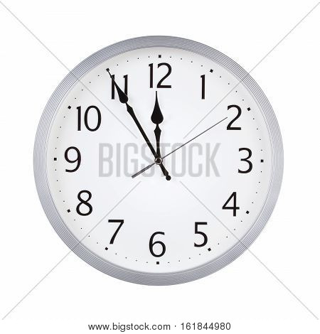 Five to twelve on the dial round clock