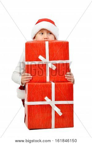 Adorable Boy In Santa Clothes Peeks Out Behind Christmas Big Gift Boxs. Isolated White Background.