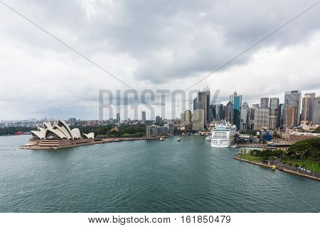 April 12, 2016 - Sydney, Australia: View of the Sydney Harbour with some ferries passing by the Sydney Opera House and the Central Business District skyline in the background in Sydney, Australia