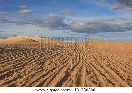Amazing view of sand dunes on the background of blue sky near Mui Ne place Vietnam