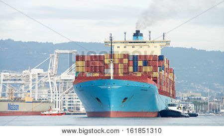 Oakland CA - December 13 2016: Cargo Ship GERD MAERSK entering the Port of Oakland the busiest port in the United States.
