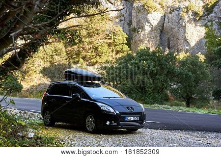 Provence France - December 2 2016: Black colour Peugeot 5008 stopped on a mountain road in France The Peugeot 5008 is a French car and has been on sale since November 2009