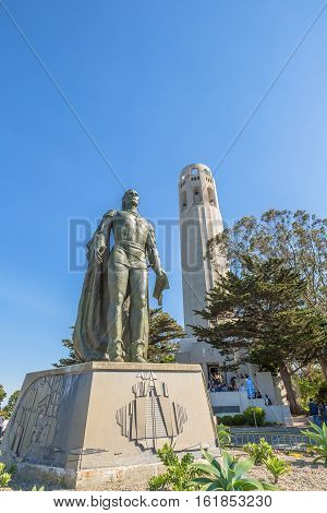 San Francisco, California, United States - August 14, 2016: The Coit Tower and a statue of Christopher Columbus in the North Beach neighborhood on Telegraph Hill, in a sunny day.
