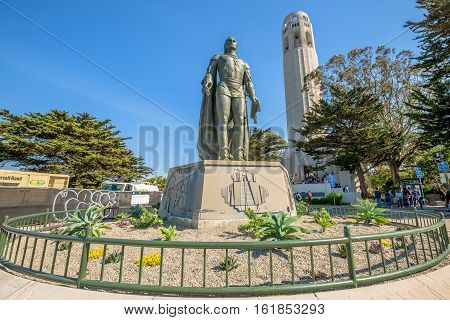 San Francisco, California, United States - August 14, 2016: The statue of Christopher Columbus and Coit Tower. People lined up to climb the tower to see the city of San Francisco to 365 degrees.