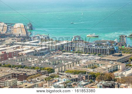 San Francisco, California, United States - August 14, 2016: aerial view of Hyde Street Pier in Fisherman's Wharf from top of Coit Tower on sunny day.