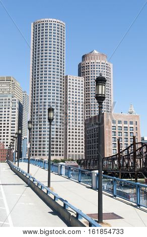 The view of bridge lampposts with Boston downtown skyline in a background (Massachusetts).