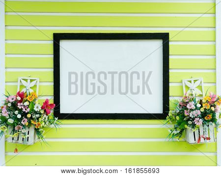 Blank sign on green wall as background