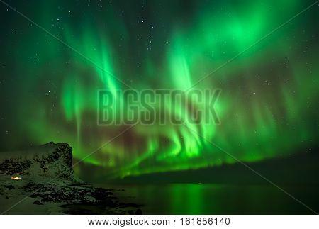 Great Aurora Borealis over Myrland village Lofoten