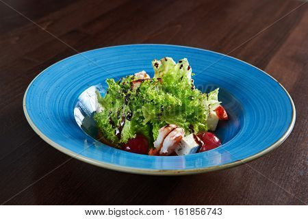 Sea food. Closeup of a delicious shrimp and cheese salad served with grapes