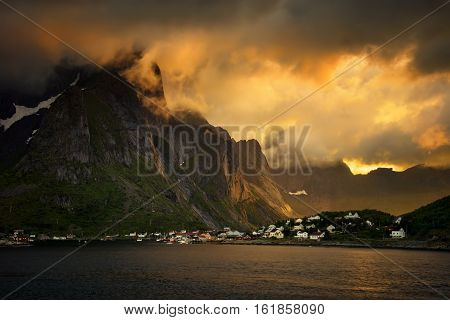 Colorful sunset over mountains and Reine village Lofoten
