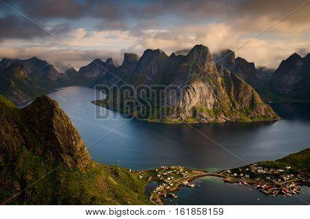 View from Reinebringen summit on Reine village and fjord in beautiful weather Lofoten