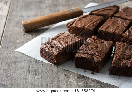 Sweet Chocolate brownie portions on wooden background