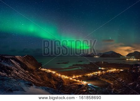 Aurora borealis over Ramberg in mountains Lofoten