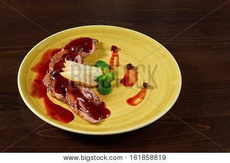 Duck fillet. Roasted duck fillet served with sliced pears at the restaurant