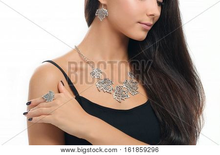 portrait of beautiful woman with long hair wearing stylish silver Jewelery. Finger ring. Necklace and earring on human model isolated on white