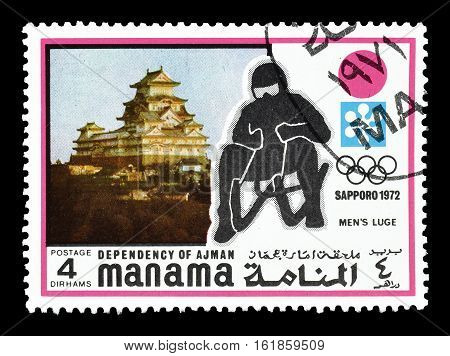 MANAMA - CIRCA 1971 : Cancelled postage stamp printed by Manama, that shows Luge.