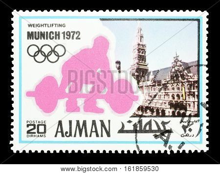 AJMAN - CIRCA 1971 : Cancelled postage stamp printed by Ajman, that shows Weight lifting.