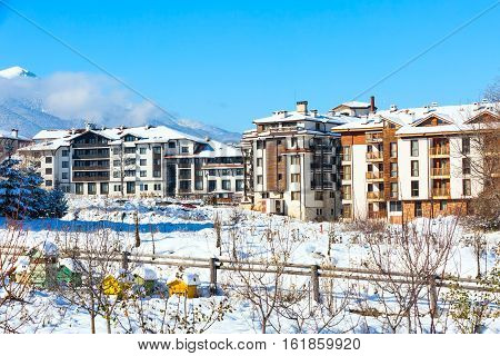 houses and snow mountains landscape panorama in bulgarian ski resort Bansko, Bulgaria