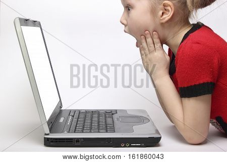 girl in awe looking at the monitor laptop. white background