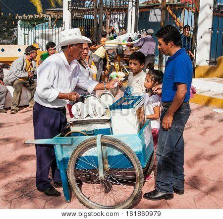 SAN CRISTOBAL DE LAS CASAS, MEXICO-DEC 11, 2015:  Man selling  traditional icecream at street market on Dec 11, 2015 in San Cristobal de las casas, Chiapas region, Mexico.