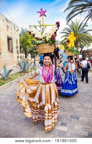 OAXACA, MEXICO-DEC 10, 2015: Beautiful lady celebrating Day of the Virgin of Guadalupe (Dia de la Virgen de Guadalupe) on Dec 10, 2015 . Oaxaca, Mexico. It is a popular Catholic feastival