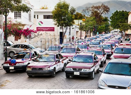 OAXACA, MEXICO- DEC 10, 2015:  Taxi column at the street of Oaxaca on Dec 10, 2016, Mexico.