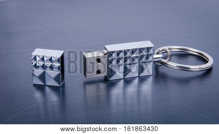 USB Flash Drive closeup on gray metal background