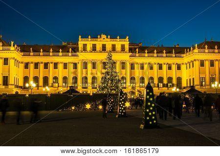 Christmas Market Vienna Schonbrunn Palace at christmas time with market and christmas tree