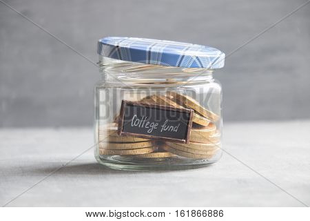 college fund label and gold coins in a glass jar