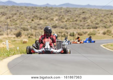 Adult Go Kart Racers on Track in formation