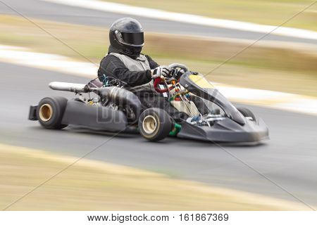 Go Kart Racer on Track Panning Shot to show speed