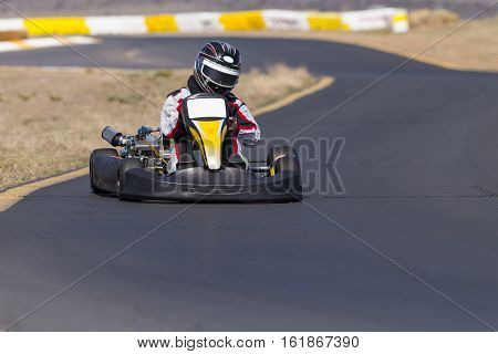 Adult Go Kart Racer on Track turning