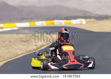 Adult Go Kart Racer on Track heading into corner