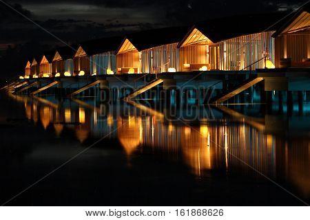 Maldivian night and bugalow over the sea